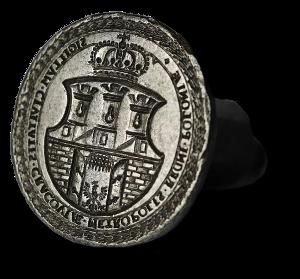Metalowy, owalny tłok pieczętny przedstawiający herb miasta Krakowa z 1661 r.